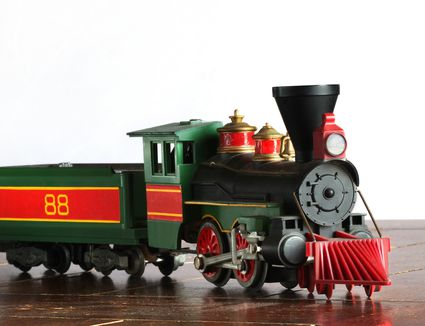 Model antique steam engine and coal car.