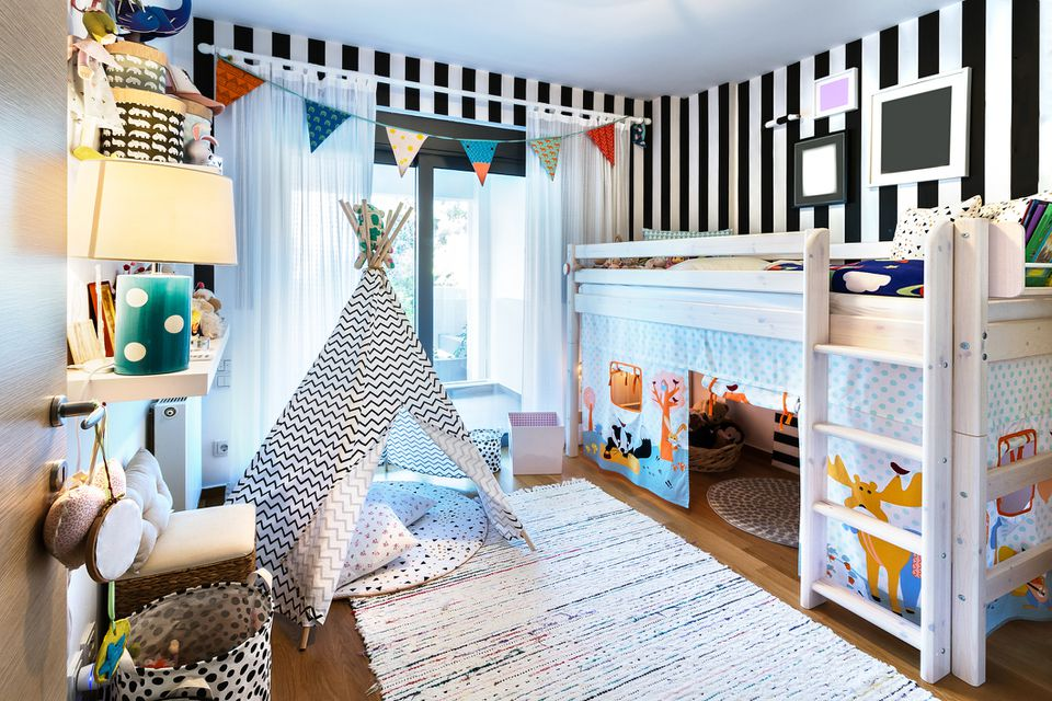 Kid bedroom with teepee and bunk bed.