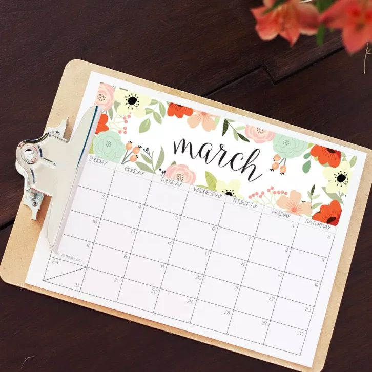 a march calendar page on a clipboard