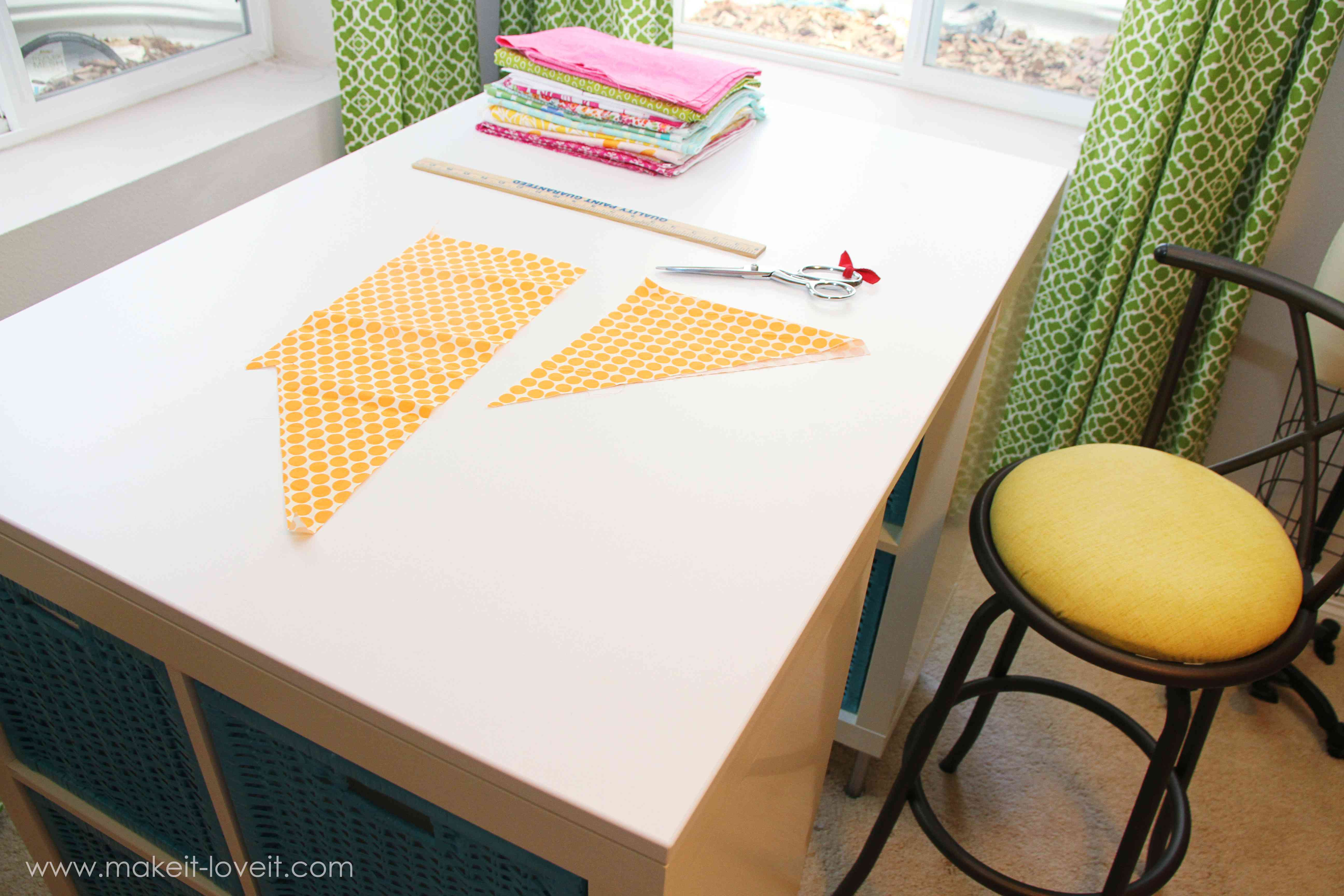 A top view of a craft table with fabric on it