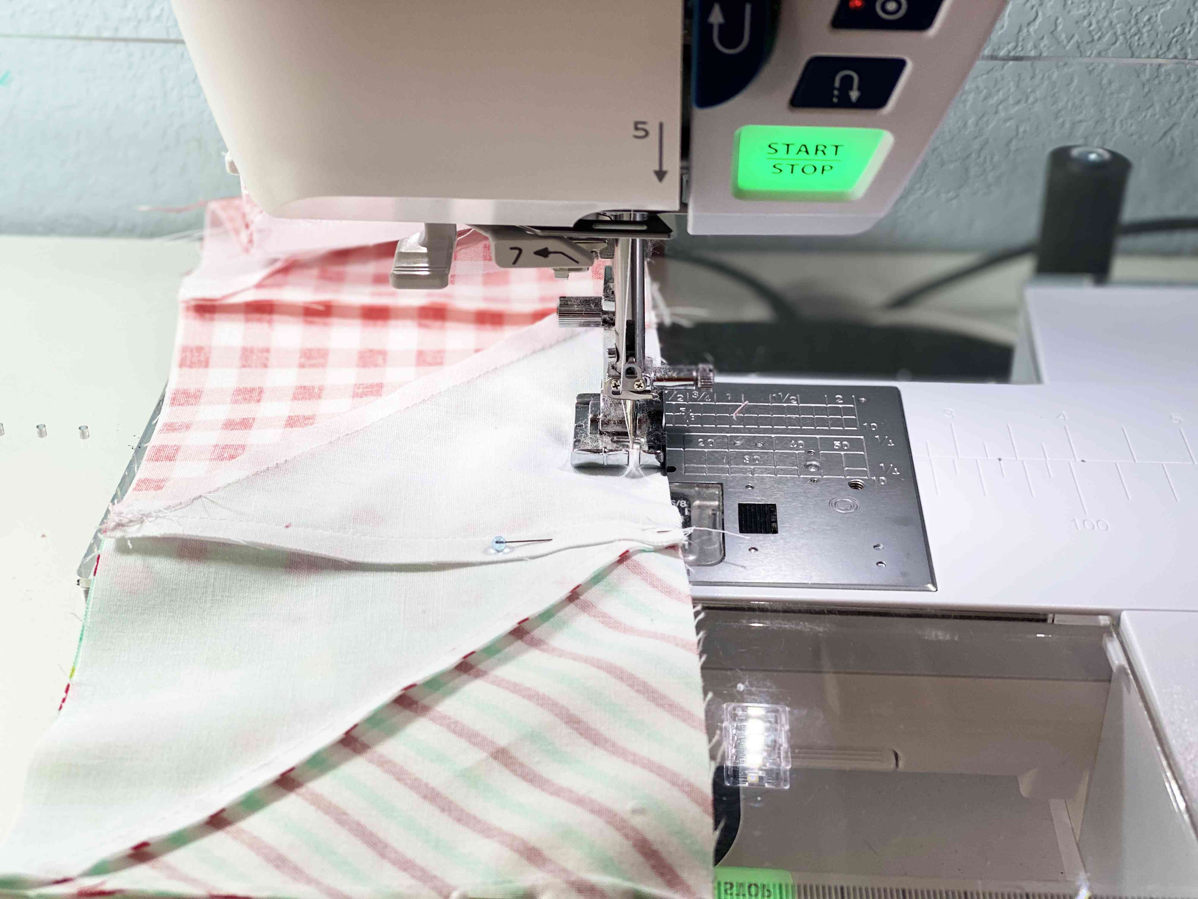 Using the sewing machine to sew together rows