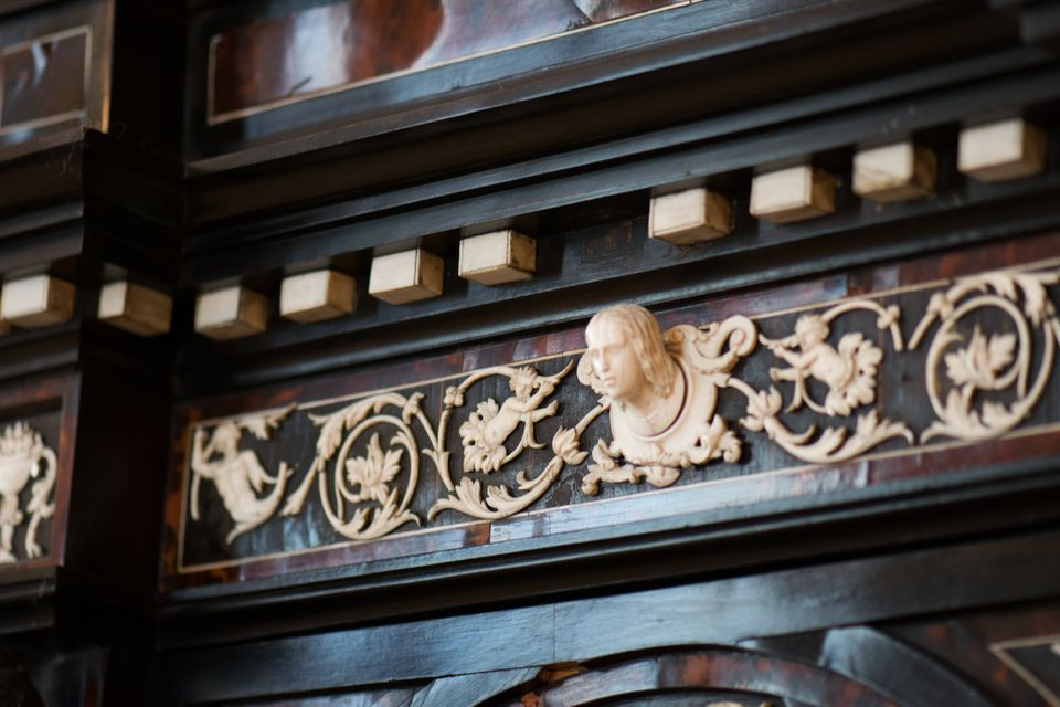 Ivory figure on antique cabinet at the Christiansborg Castle