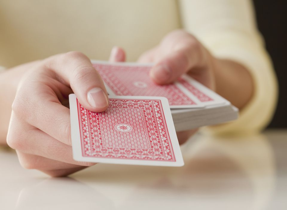 person holding deck of cards