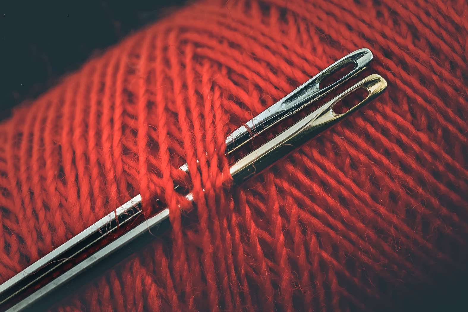 Knitting needles placed in yarn.