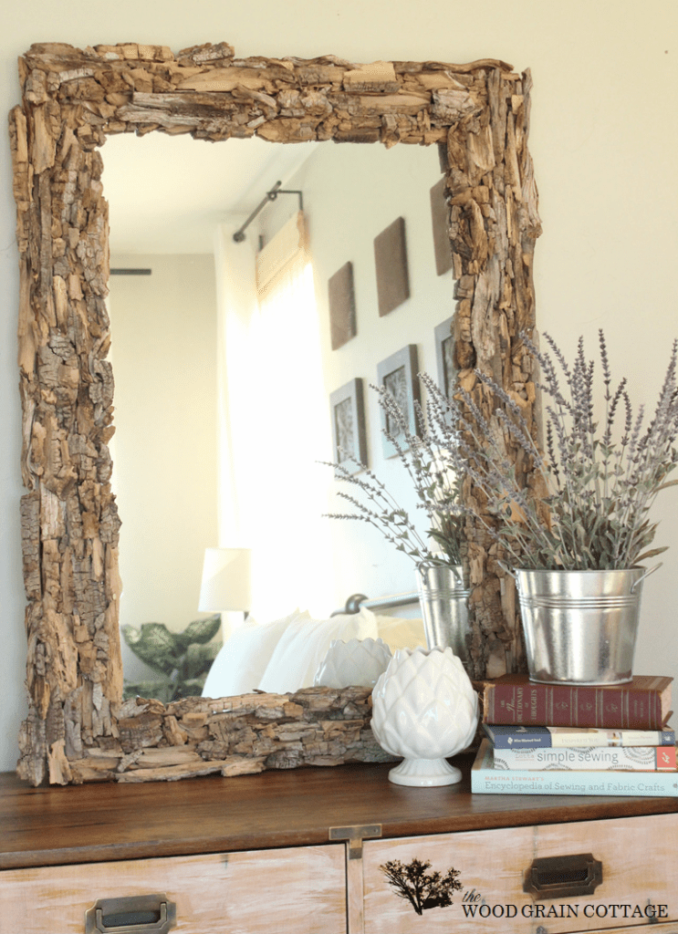 Bedroom mirror surrounded by driftwood frame.