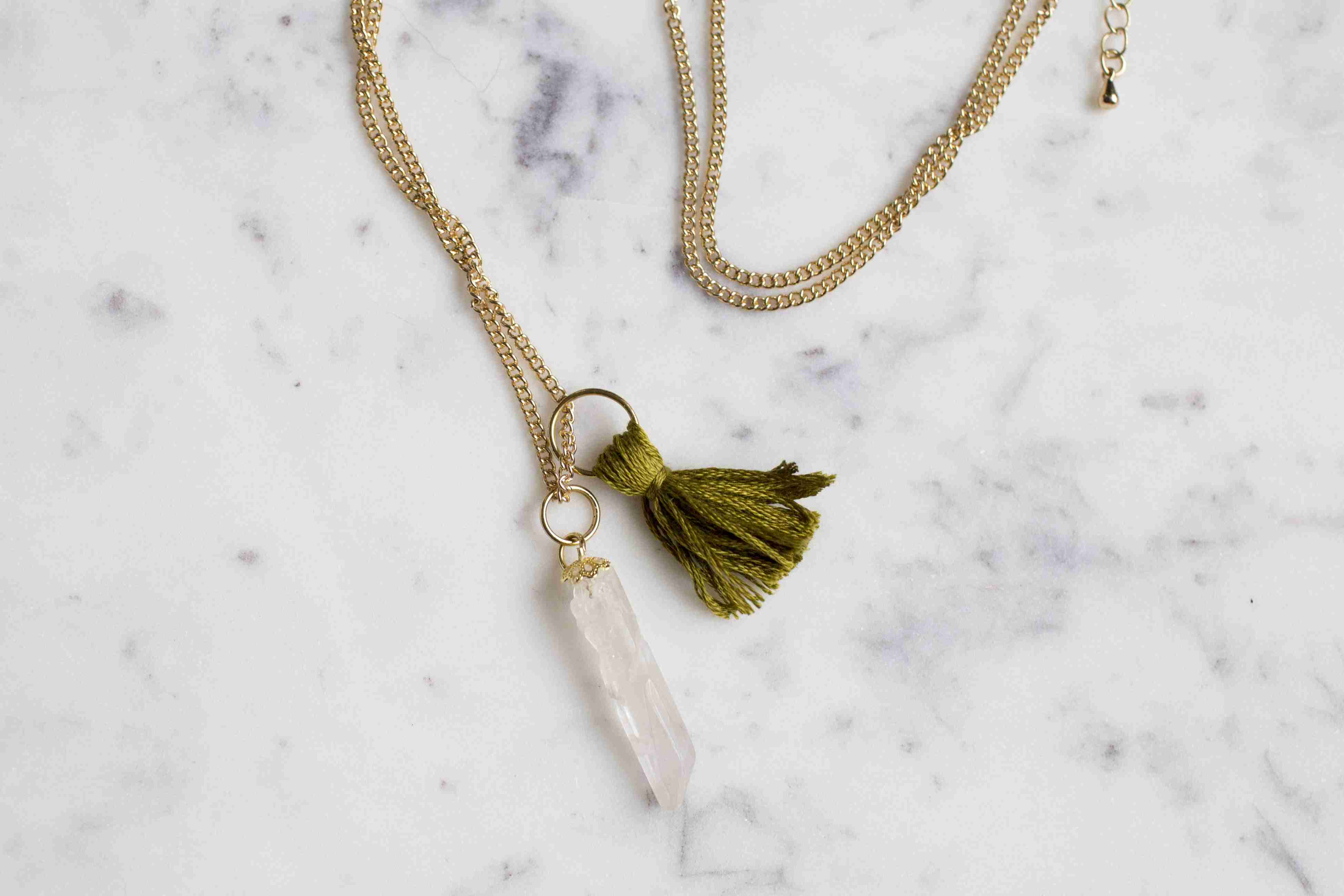 Finished stone and tassel necklace