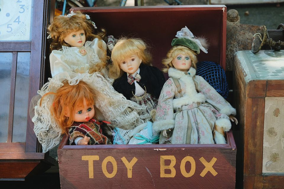Close-up of dolls in toy box