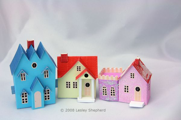 Three Putz style printable miniature cottages in N scale for a Christmas village display.