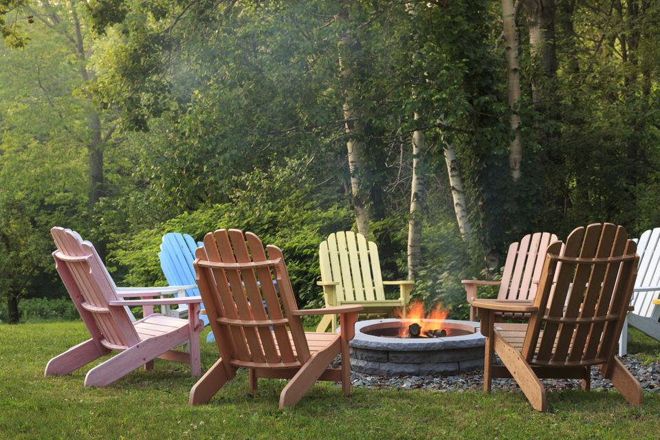 Chairs surrounding an outdoor fire pit
