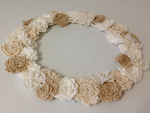 Lace and delicate crochet flowers make a pretty wedding wreath.