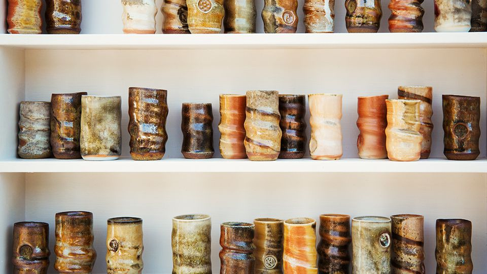 Handmade pottery on shelves