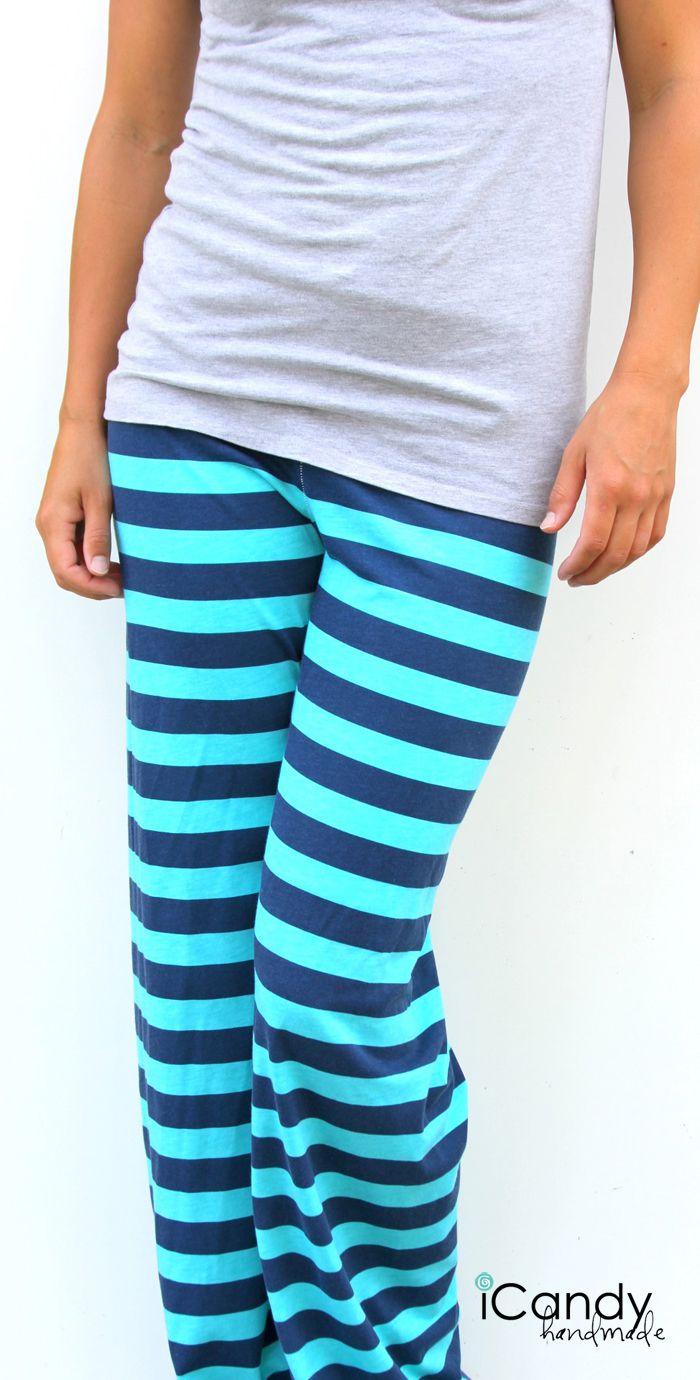 A woman wearing blue striped knit pajama pants