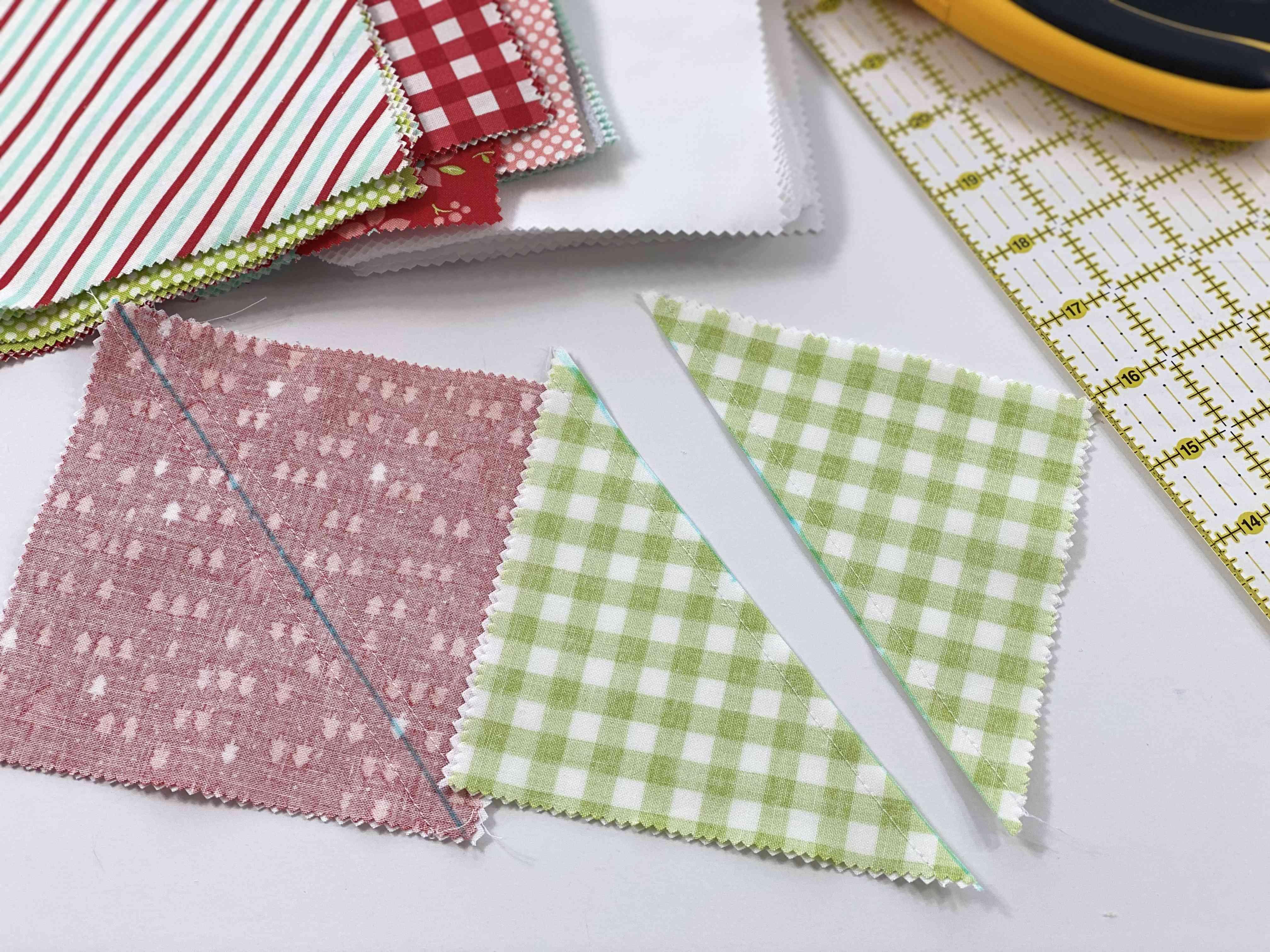 Cutting fabric to make half square triangles