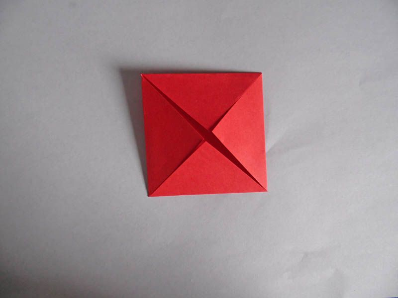 How to make an easy origami rose step 2 fold a blintz base mightylinksfo