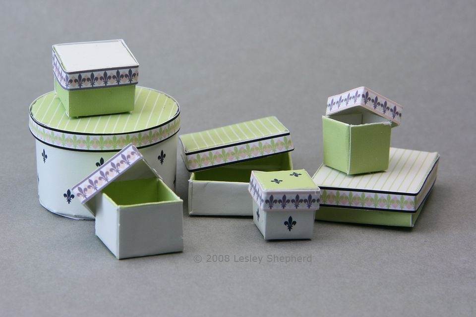 Lined printable boxes with separate lids for miniature or dolls house scale shops.
