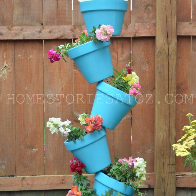 Terracotta pots stacked as a bird feeder