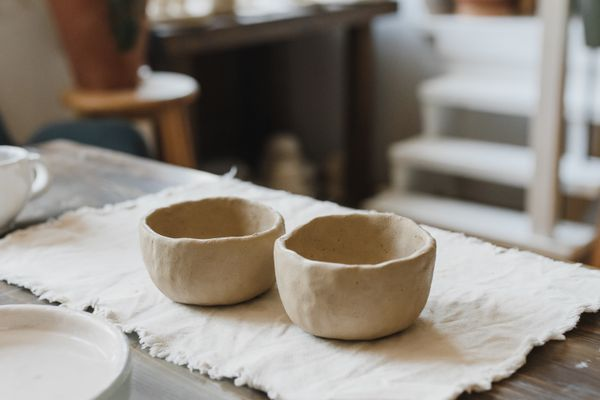 Two clay cups on the table