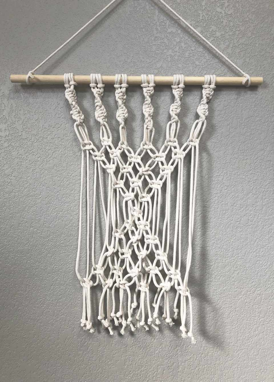 A macrame wall hanging