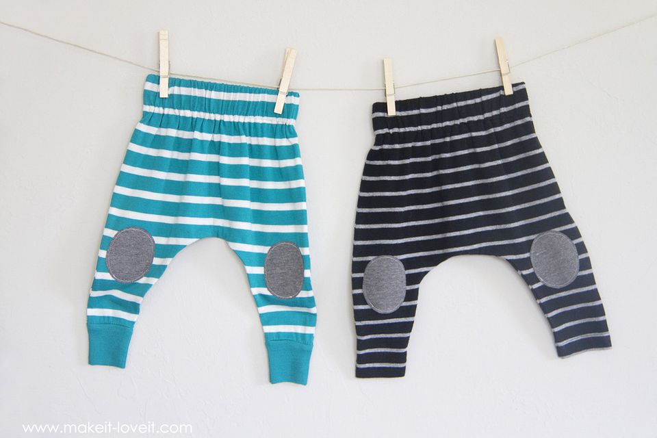 Blue and black baby leggings hanging on a clothesline