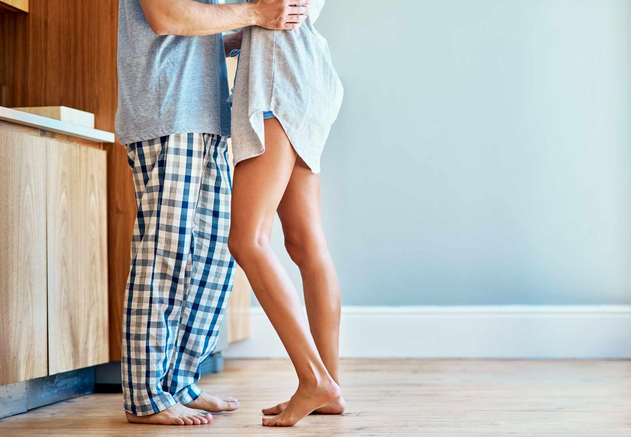 A Couple wearing pajamas at home