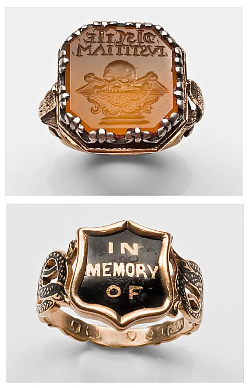 """Louis XIV carnelian memento mori intalgio ring with skull carving, c.1680 (top); """"Mary Ann Lewis"""" """"In Memory Of"""" ring, featuring black enamel serpents coiled across the shoulders and a hair compartment under the bezel, 1853"""