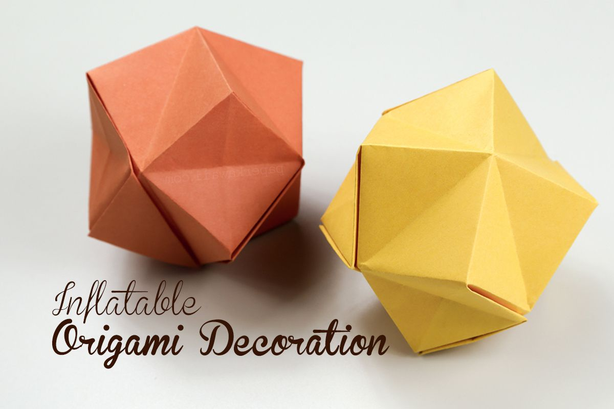 Inflatable origami stars in orange and yellow.