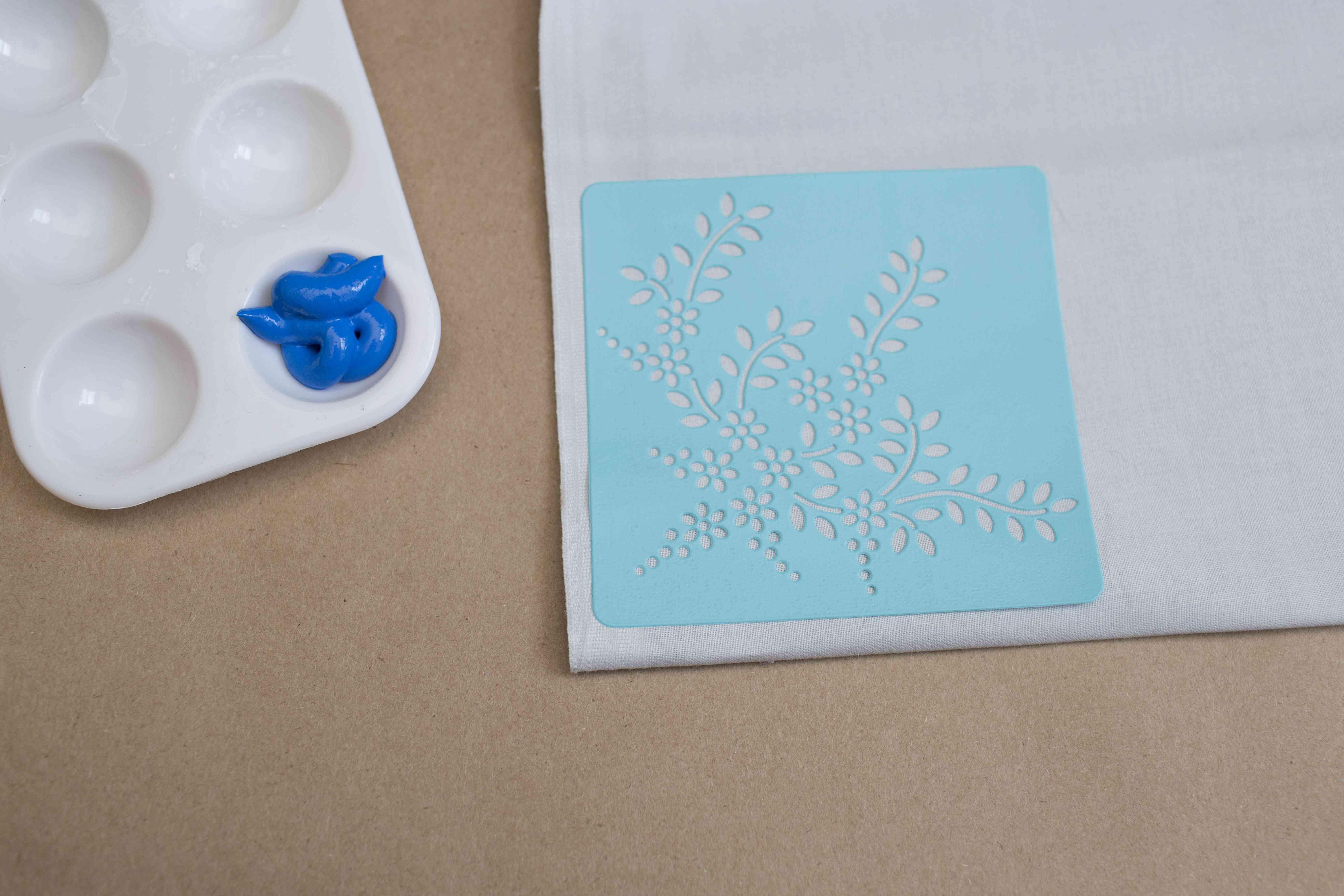 Placing stencil on fabric