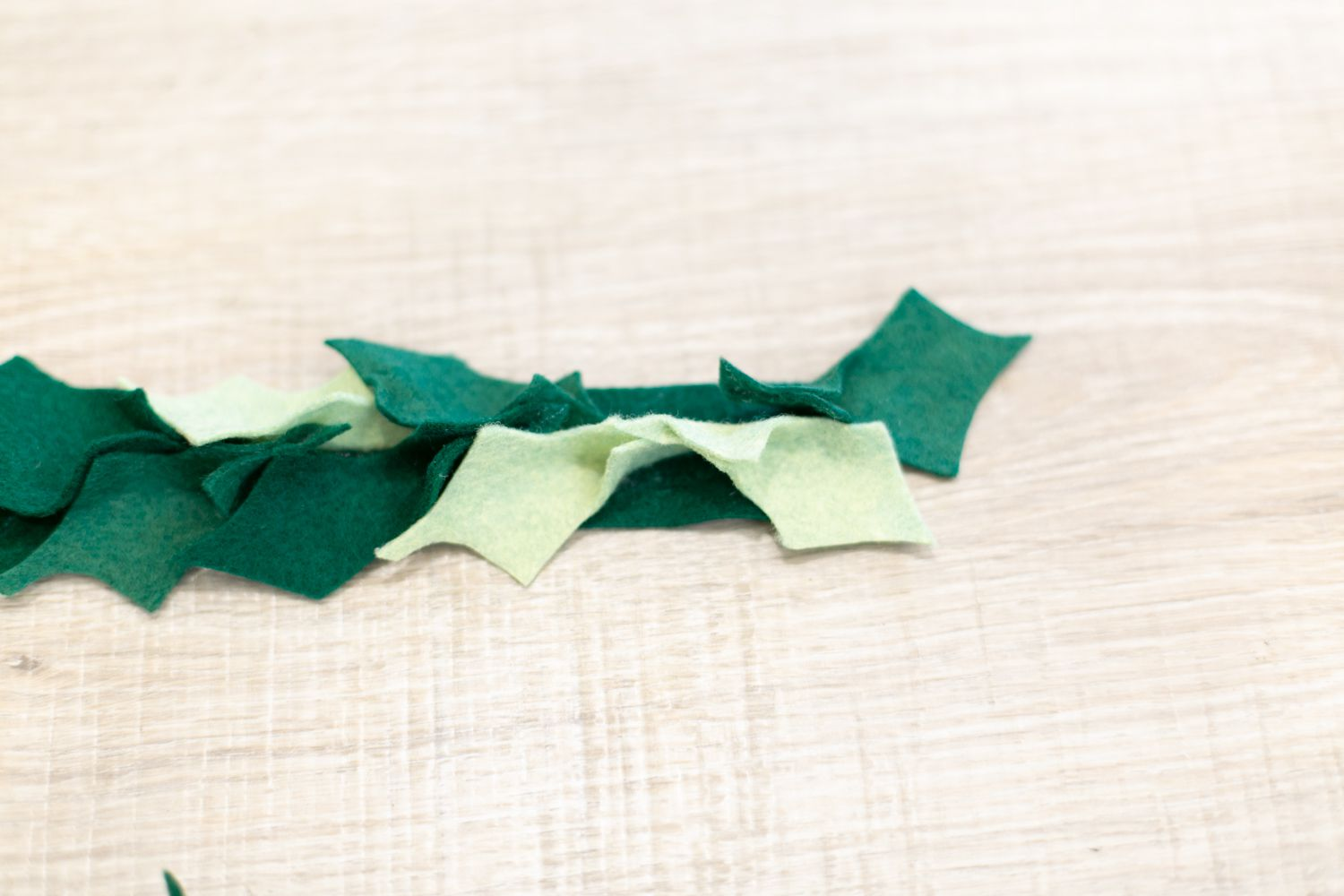 Finishing the end of a holly garland