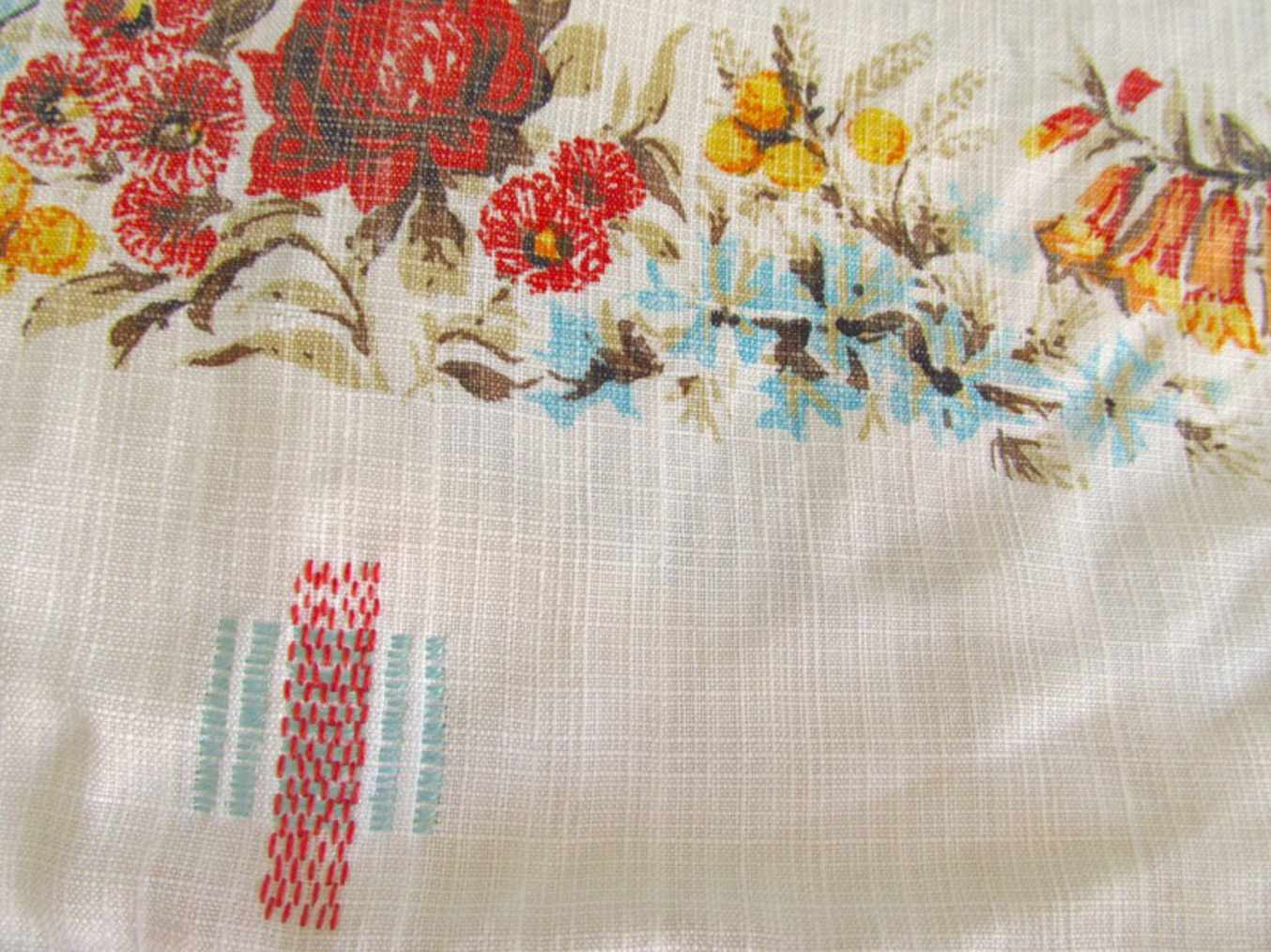 Repairing textiles with stitching