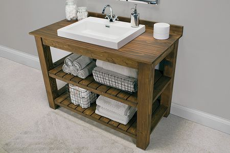 A Wooden Diy Bathroom Vanity With Two Shelves