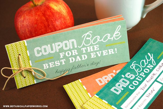 A coupon book for dad, an apple, and a cup of coffee.