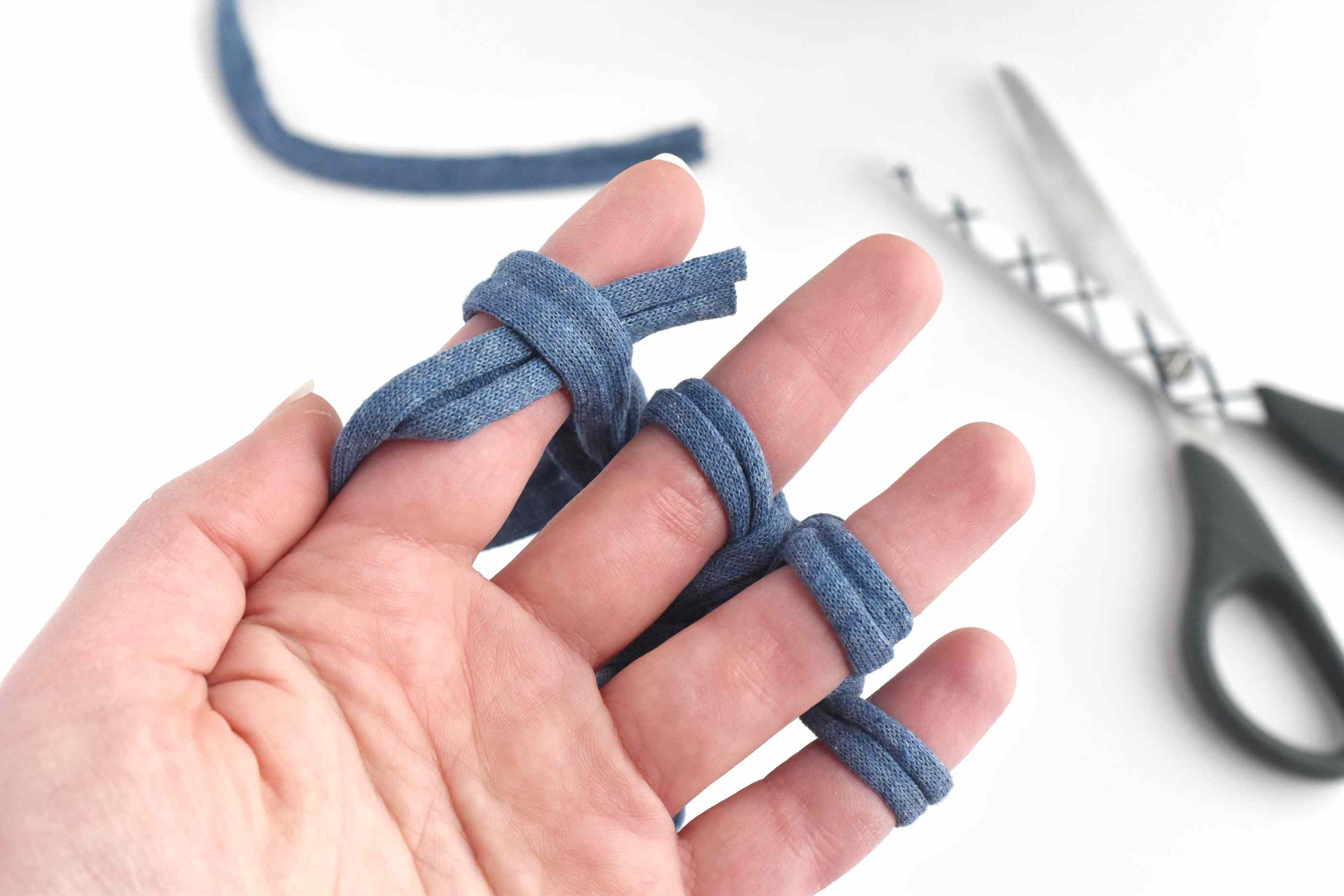 Slip the Yarn End Through the Stitches to End