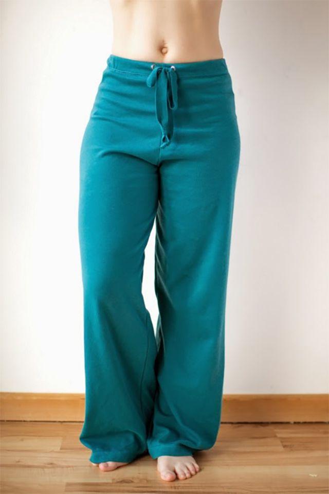 A woman wearing teal yoga pants