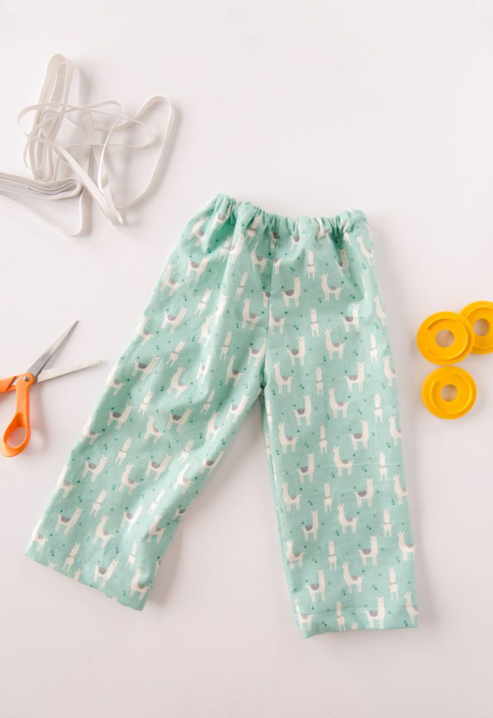 A pair of kids pj pants with sewing notions