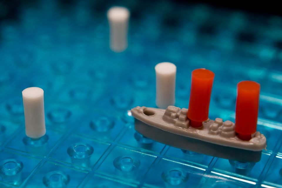 Battleship pieces on a board