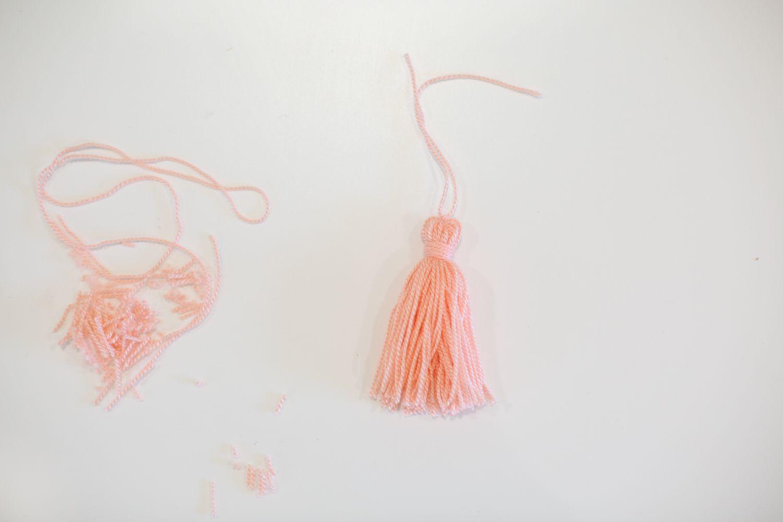 Trim bottom of yarn tassel