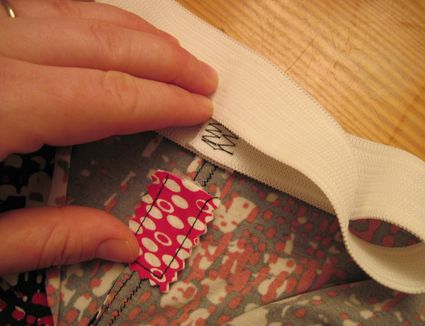 Preparing to attach waistband, anchoring the tag with fusible web