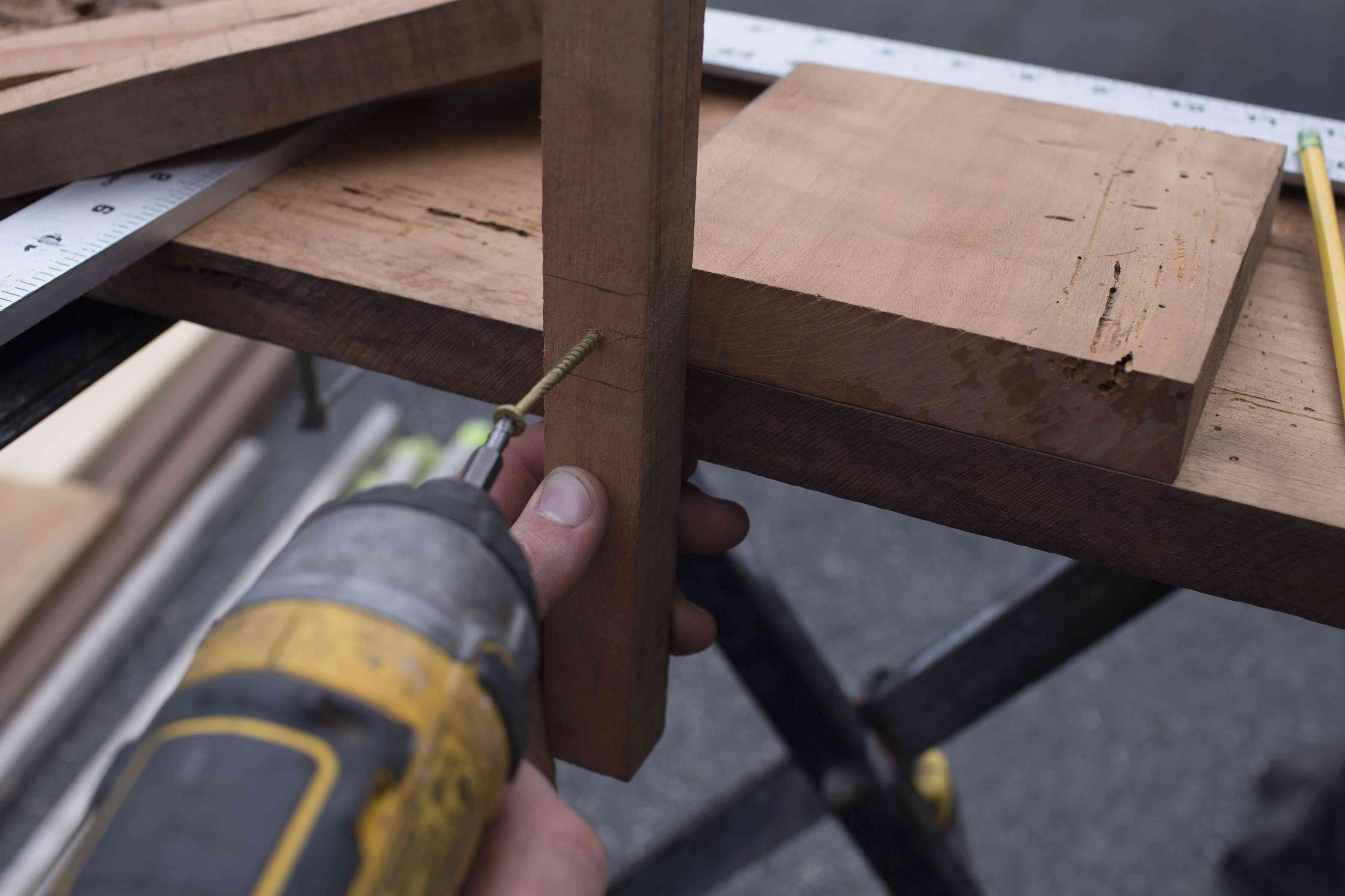 Screwing on the wood legs.