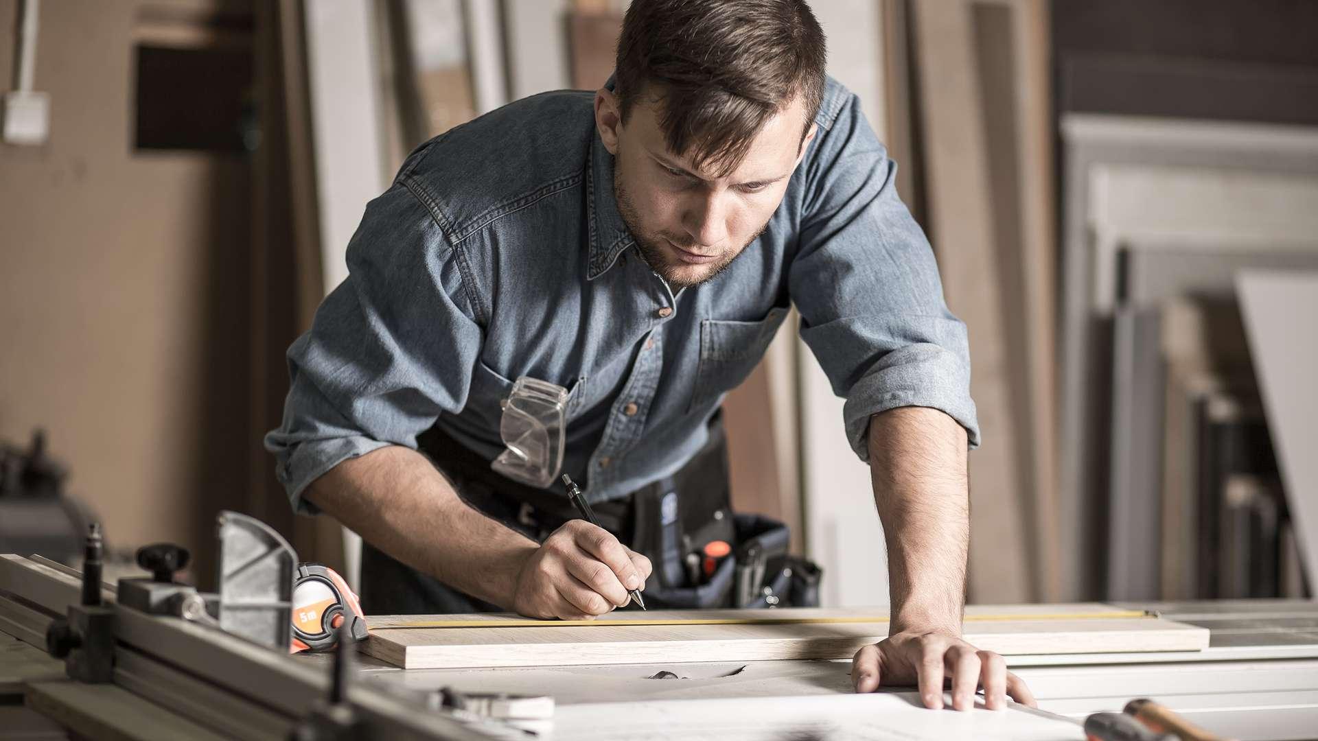 A man woodworking