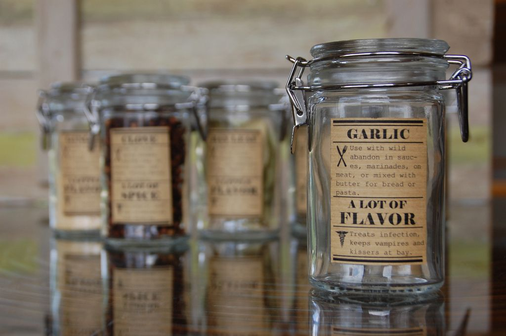 Vintage spice labels on jars.