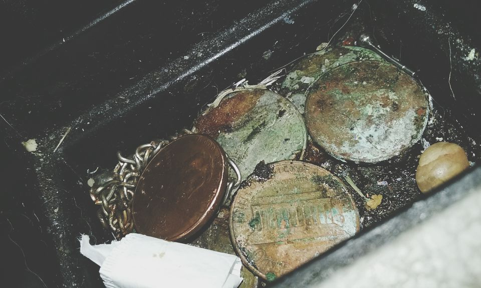 dirty coins in a box
