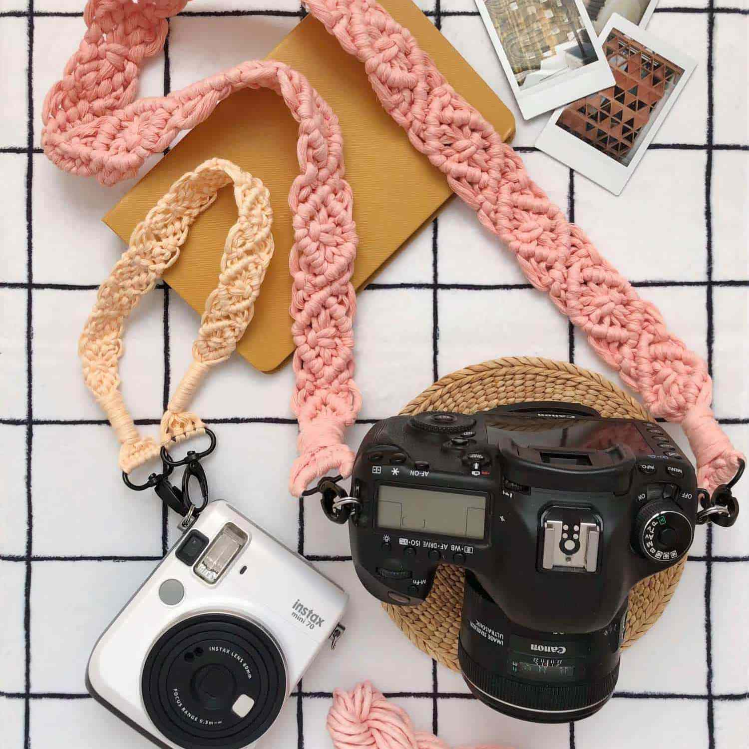 Two cameras with colorful macramé straps