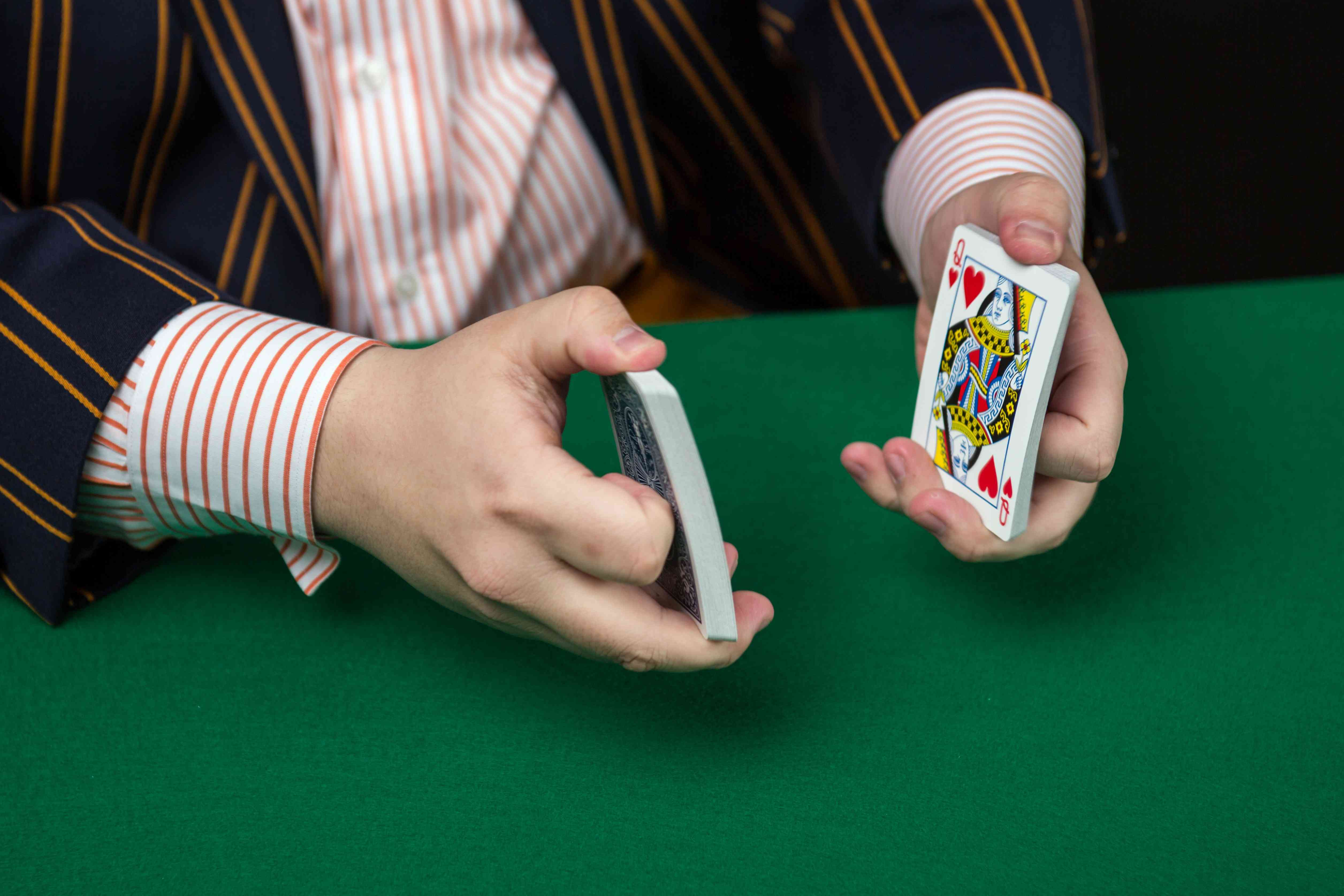 One half of the deck of cards is in each hand