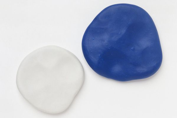 Two Flat Round Pieces of White and Blue Polymer Clay