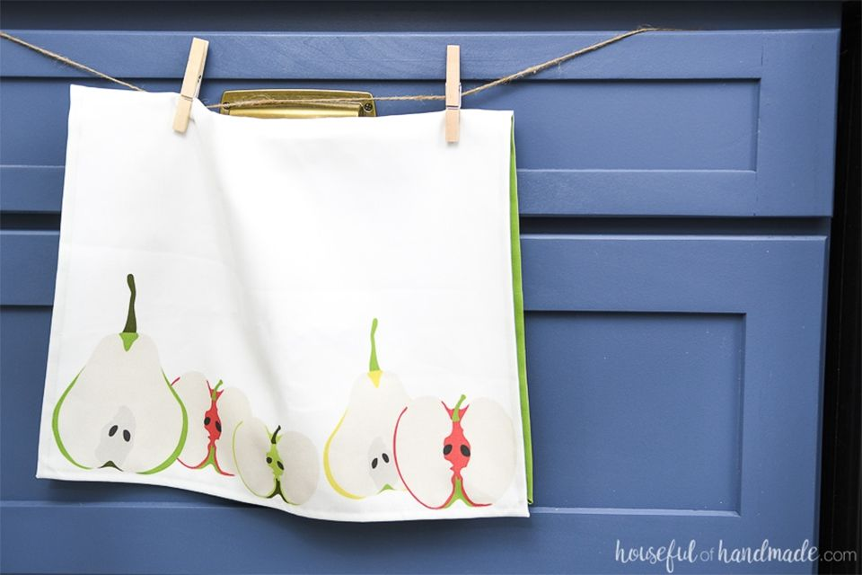 A tea towel hanging by clothespins