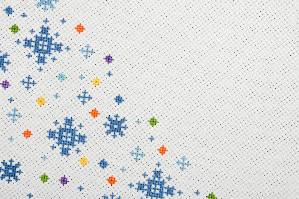 Colorful snowflake cross stitches