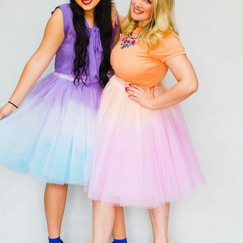 Two women wearing ombre-colored tutus