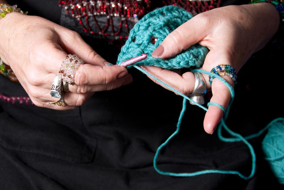 Woman crocheting the afghan stitch