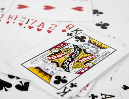 Playing cards spreaded on the white background