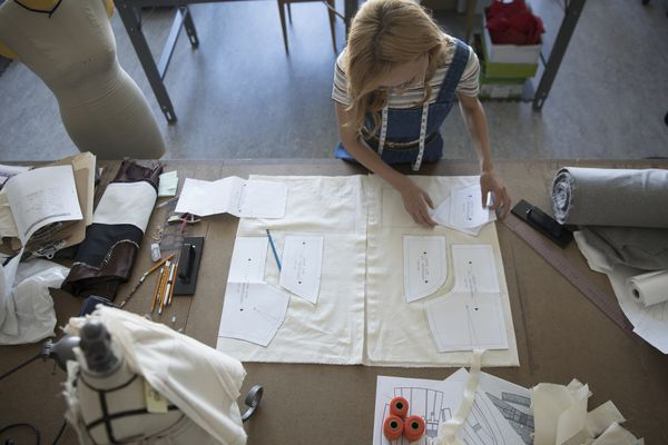 Woman using sewing patterns